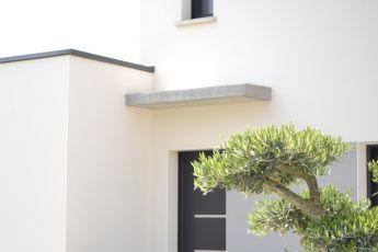 Entrée maison nord-loire, toit plat et ardoise noire, maison contemporaine réalisée par maisons bouvier